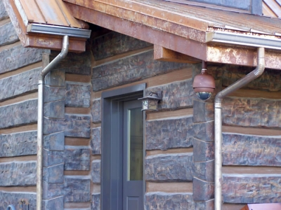 K-style vintage rusted gutter with round downspout
